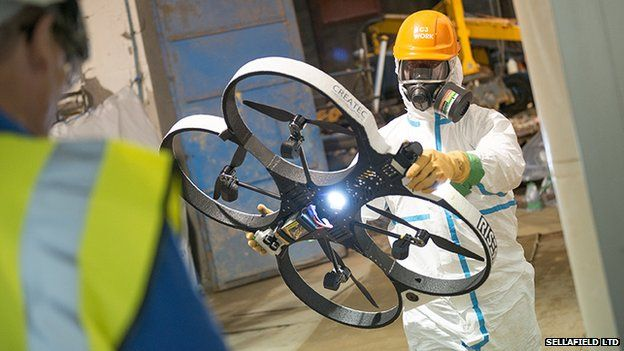 Man holding quadcopter drone