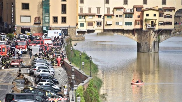 Vehicles are stuck in a chasm near Ponte Vecchio, Florence, Italy, 25 May 2016