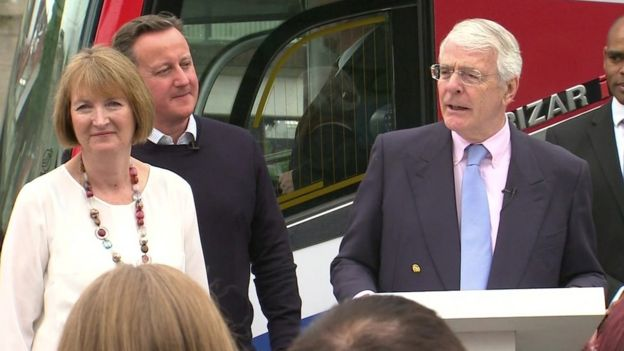 David Cameron and Harriet Harman listen to Sir John Major speaking