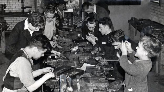 Large group doing woodwork 1930s