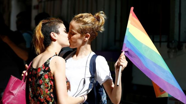 activists kiss at the banned Istanbul Trans Pride event, 19 June