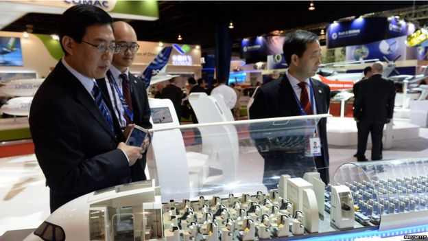 A guest looks at the cabin interior of the model display of an Airbus A350-XWB plane at the Singapore Airshow