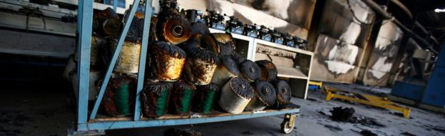 Torched bundles of woven fabric are seen in a textile factory damaged by protests in the town of Sebeta, Oromia region