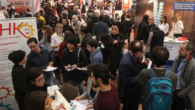Jobs fair for refugees and migrants in Berlin