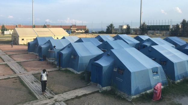 A temporary refugee centre in a sports ground in Messina