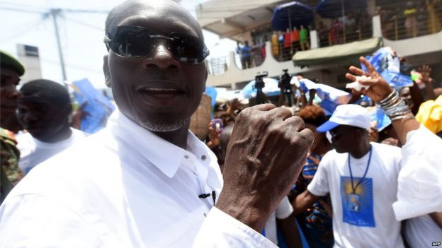 A picture taken on 4 March 2016 shows cotton tycoon and presidential candidate Patrice Talon arriving for a rally in Cotonou, Benin.