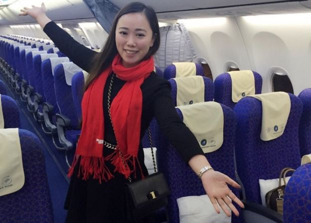 Ms Zhang poses in the empty cabin