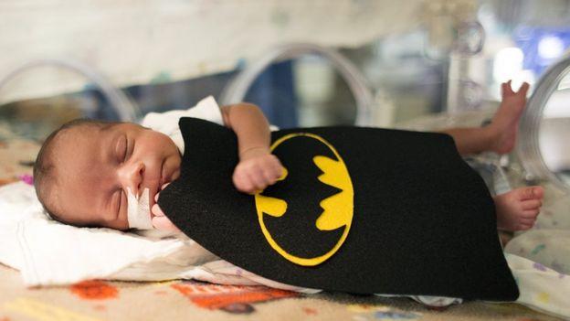 Baby in a Batman costume