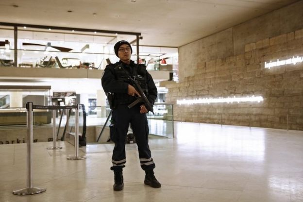 A French policeman stands guard inside The Louvre Museum, Paris, on 3 February 2017