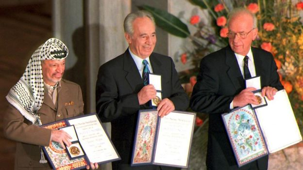 Palestinian leader Yasser Arafat, then Israeli Foreign Minister Shimon Peres, and late Israeli Prime Minister Yitzhak Rabin as they pose with the Nobel Peace Prize, 1994.