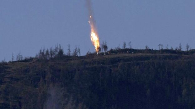 A still from video footage shown by the HaberTurk TV Channel shows a plane coming down near the Turkish-Syrian border on 24 November 2015