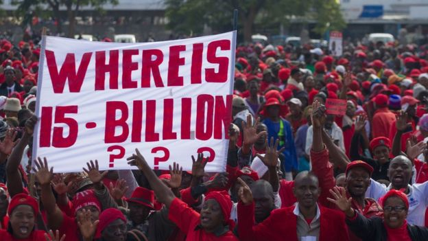 Zimbabwean opposition Movement for Democratic Change (MDC) supporters shout political slogans and hold placards during a protest against the government on 28 May 2016 in Bulawayo, Zimbabwe