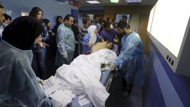 Medics help an injured child inside a hospital after suicide bombers targeted Beirut's southern suburbs (12 November 2015)