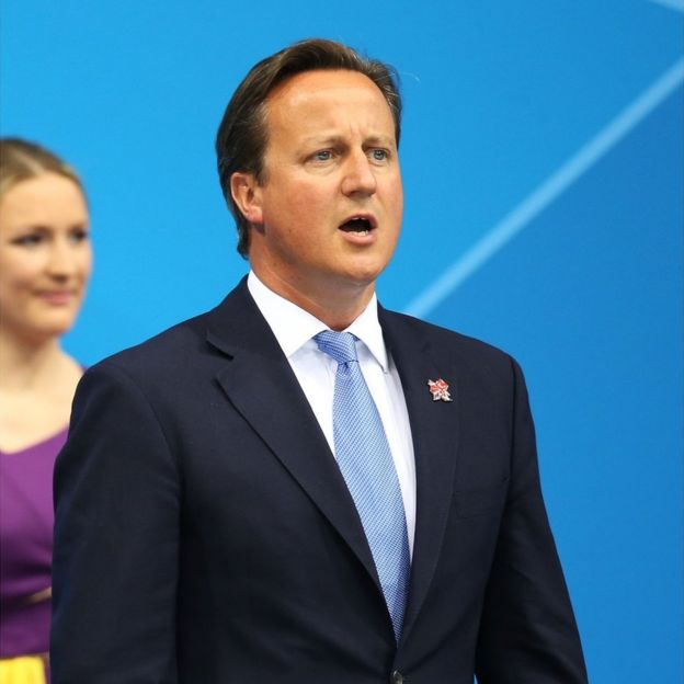 David Cameron sings the national anthem after presenting Eleanor Simmonds with her gold medal on day 5 of the London 2012 Paralympic Games at Aquatics Centre on September 3, 2012 in London, England