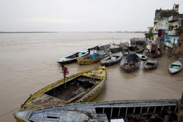 In this Friday, Aug. 26, 2016 photo, boats are docked at the Manikarnika Ghat, submerged by the flood waters in Varanasi, India.