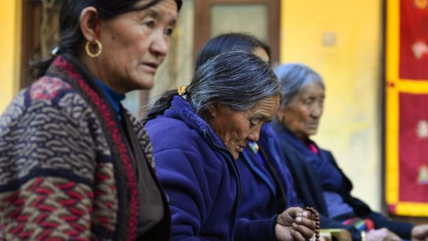 Nepalese women pray in the monastery where the remains of Jigme Dorje Palbar Bista, the last king of former Himalayan kingdom of Upper Mustang, is kept, 16 December 2016