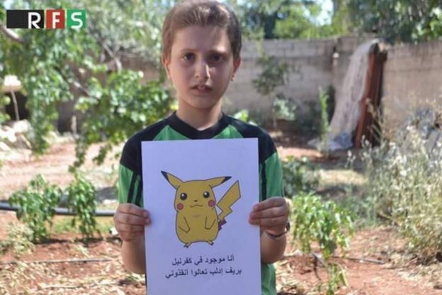 Boy holding Pokemon picture with caption asking for help