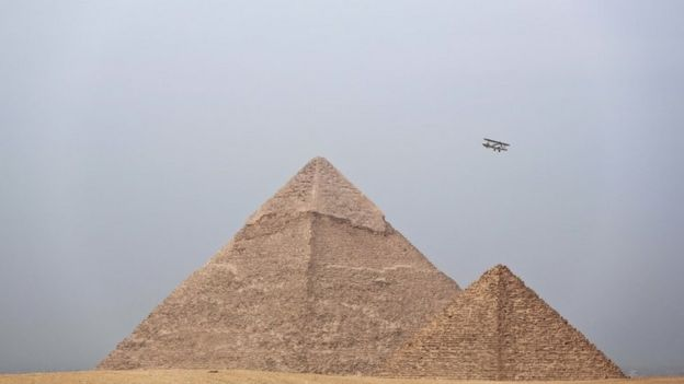 Egyptian medical doctor and pilot, Yasser Mohammed Minsy, and Belgian commercial pilot Cedric Collette, fly a vintage airplane during a rally across Africa, at the Giza Pyramids in Egypt (13 November 2016)