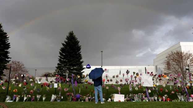 A rainbow appears over Paisley Park near a memorial for Prince, Thursday, April 21, 2016, in Chanhassen, Minn. Prince