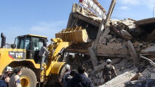 Workmen at the site of the bombed hospital (15 February 2016)