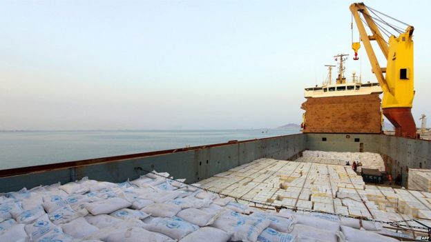 A handout picture released by the World Food Programme (WFP) shows a UN aid ship docked in Yemen's port city of Aden on (21 July 2015)
