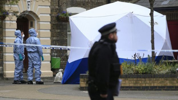 Police outside Southwark flat where human remains were found on 7 April