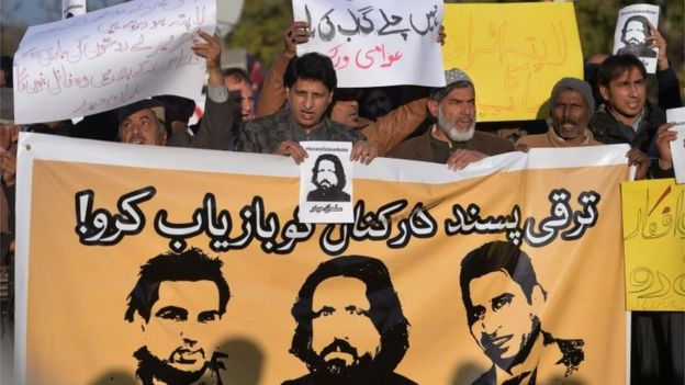 Pakistani human rights activists hold images of bloggers who have gone missing during a protest in Islamabad on January 10, 2017.
