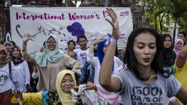 Indonesian women dance in Yogyakarta during an International Women's Day celebration on March 8, 2017 in Yogyakarta, Indonesia