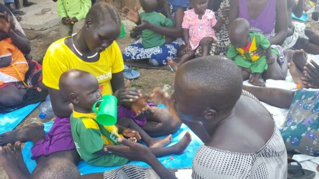 People looking after children rescued from their South Sudanese captors, Gambella, Ethiopia