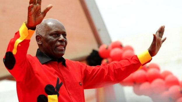 Angolan President Jose Eduardo dos Santos Angolan greets the crowd on August 29, 2012 during the final election campaign rally in Kilamba Kaixi on the outskirts of Luand
