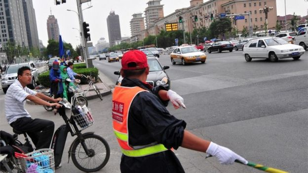 Traffic warden, China (Getty Images)