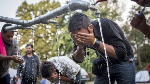 Migrants wash at reception centre in Beli Manastir, near the Croatian-Serbian border - 18 September