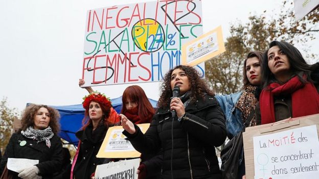 Women gather at Place de Republique to protest unequal pay (Photo Courtesy of BBC)