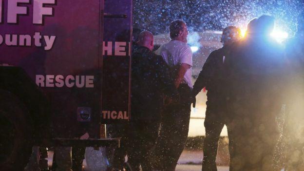 Suspect is taken into custody outside a Planned Parenthood centre in Colorado Springs, Colorado November 27, 2015