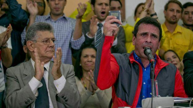 Henry Ramos y Henrique Capriles