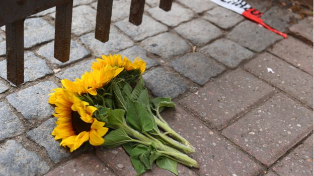 Flowers lie near the area of a suicide bomb attack at a music festival on July 25, 2016 in Ansbach, Germany.