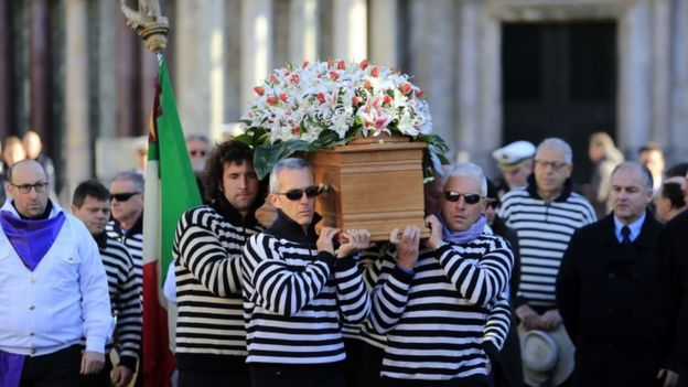 The coffin of Valeria Solesin, who died at the Bataclan, is carried through Venice's San Marco Square