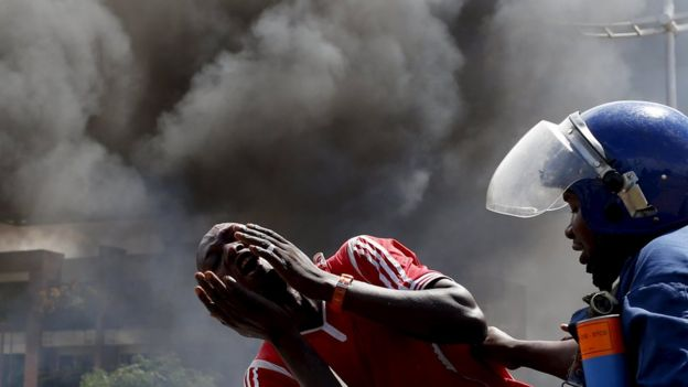 A protesters cries as he his detained during a protest in Burundi