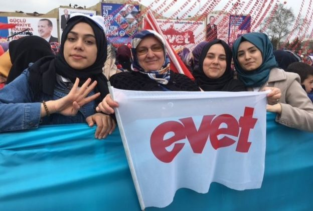 A picture of Kubra Husnan, Esma Koc and two other supporters waving a