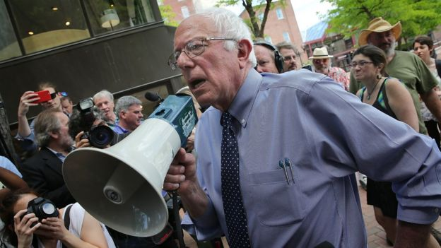 Sanders speaks to supporters through a bullhorn