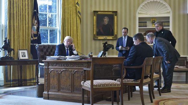 Trump y colaboradores