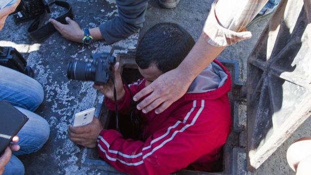 A journalist enters a manhole of the sewer system through which drug kingpin Joaquin