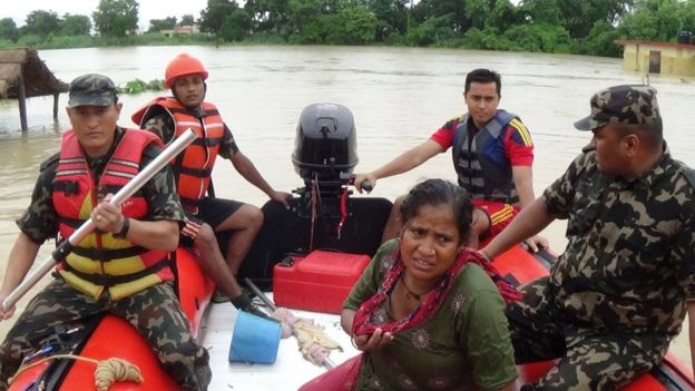 Nepalese soldiers rescue flood victims in an area around 200 km west of Kathmandu