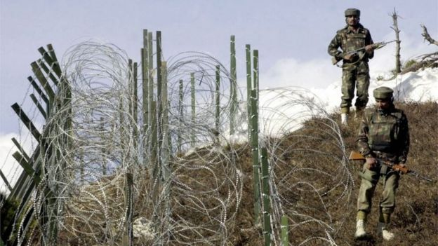 This file photograph taken on December 4, 2003, shows Indian soldiers as they patrol along a barbed-wire fence near Baras Post on the Line of Control (LoC) between Pakistan and India some 174 kms north west of Srinagar.