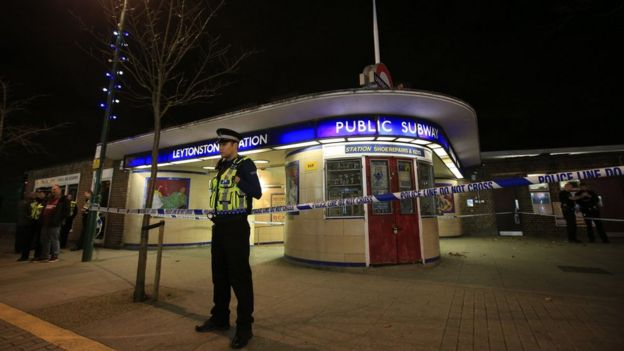 Police officer outside cordoned-off Leytonstone Tube station