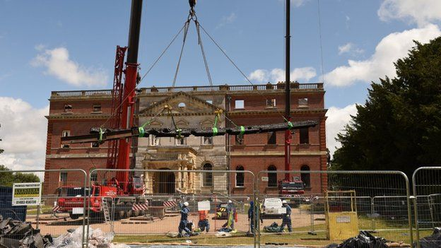 Cranes being used lift timber beams
