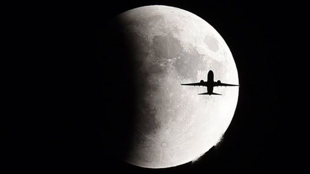 Plane and moon
