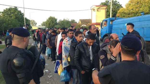 Migrants queue for coaches for registration centres in Tovarnik, Croatia - 18 September