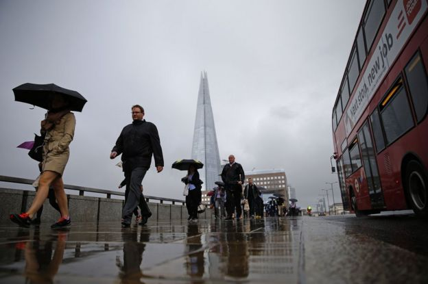 Commuters head into the City of London across London Bridge, 27 June