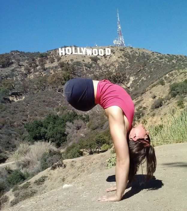 Jennifer does a handstand in front of the Hollywood sign